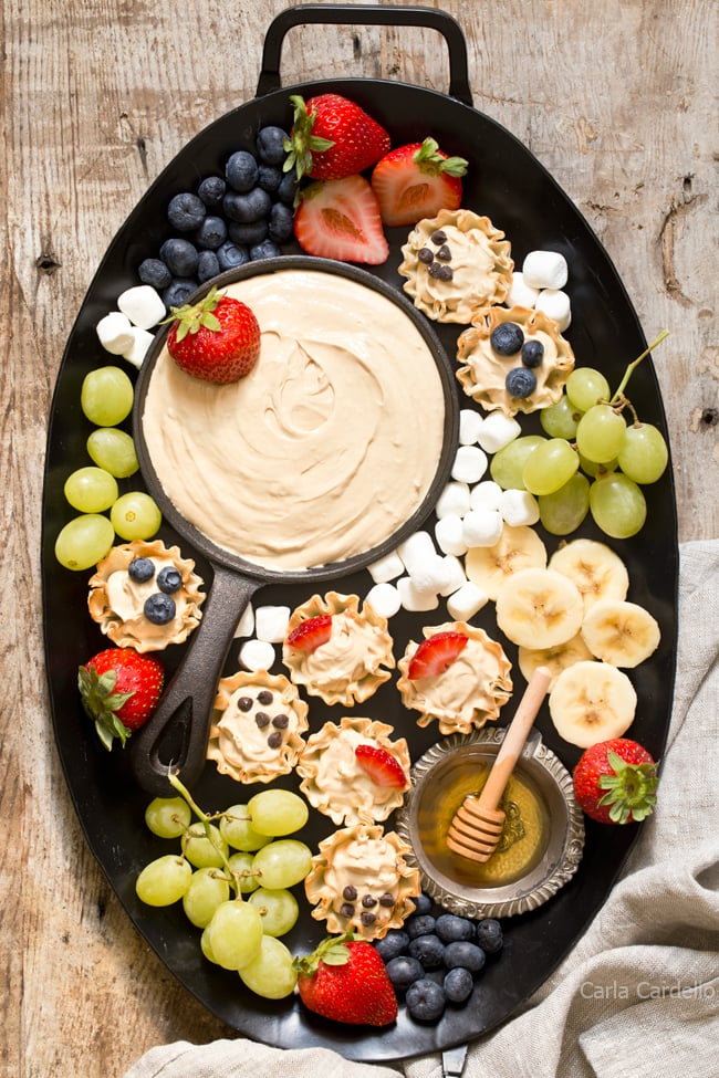 Make snack time more exciting with no bake mini Peanut Butter Fruit Dip Phyllo Cups made with marshmallow creme and Greek yogurt.