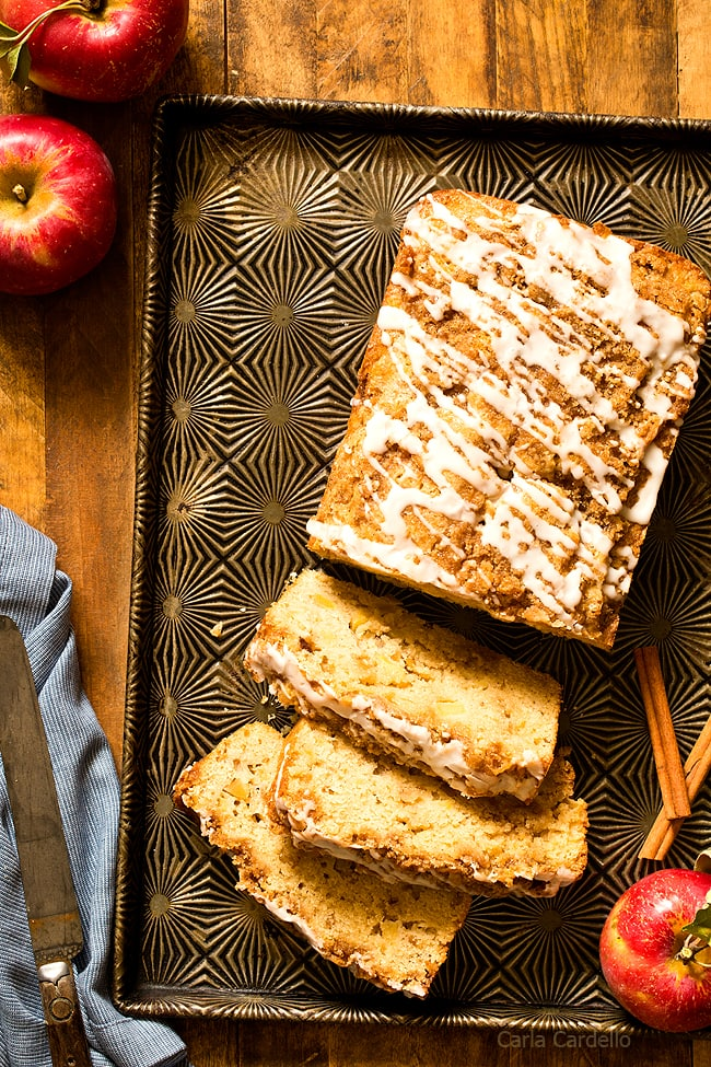 Warm up your kitchen for fall baking with Cinnamon Apple Bread topped with cinnamon streusel and a simple white icing.