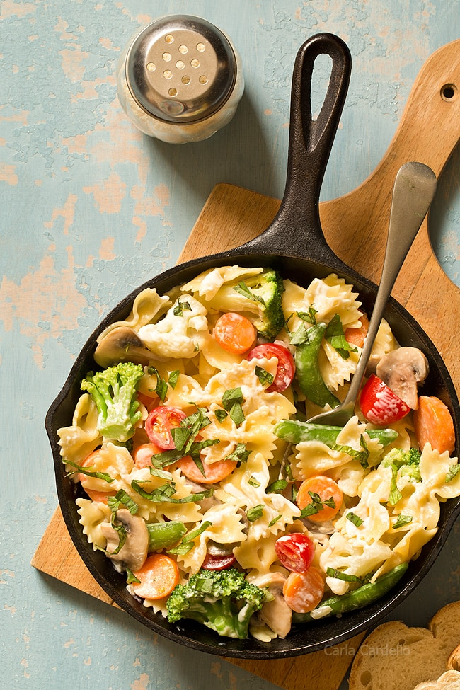 Get your daily serving of vegetables with One Skillet Pasta Primavera with a creamy Parmesan sauce! Customize your dinner by adding chicken, shrimp, and/or your favorite vegetables.