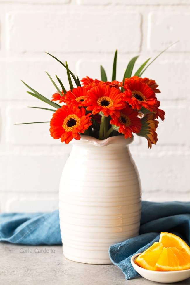 Orange Flowers In A White Vase