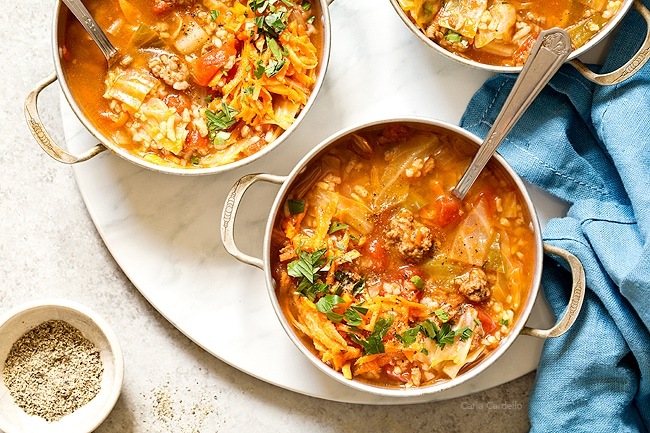 Love cabbage rolls but hate making them? Stuffed Cabbage Soup has the same ingredients as stuffed cabbage rolls - ground beef, rice, tomatoes, and cabbage - minus the extra time and effort to assemble them.