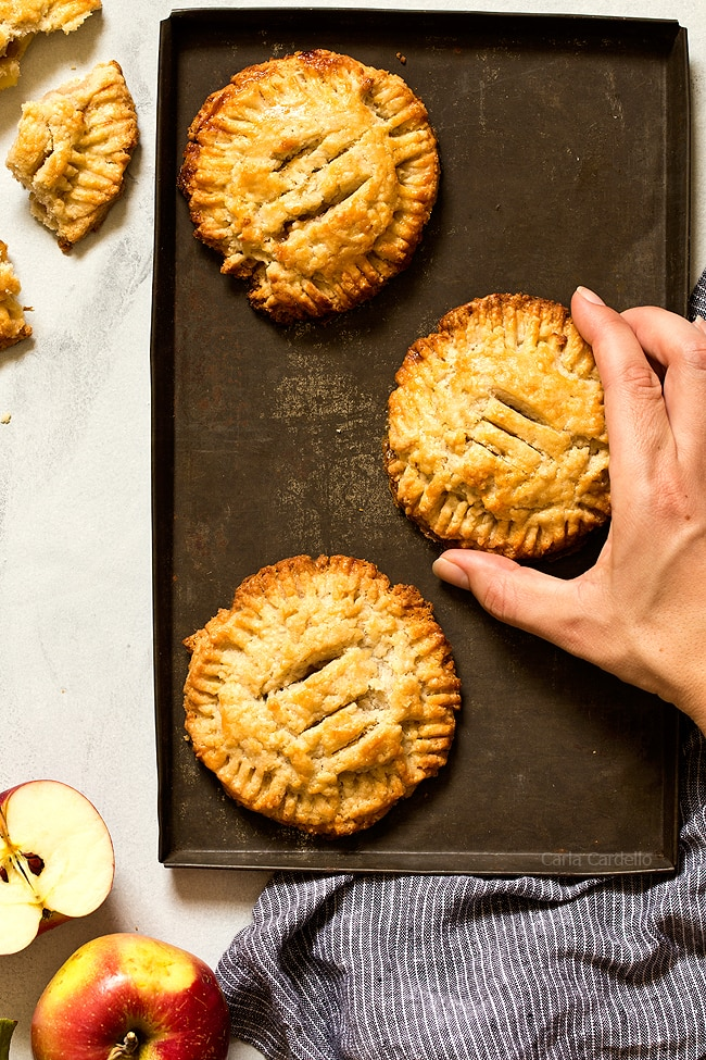 These small batch Apple Hand Pies made with pie crust are a taste of fall in every bite! This recipe freezes well, so you can make them ahead of time and bake when ready.