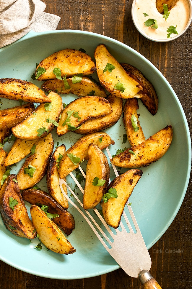 Learn how to make fried potato wedges that are super crispy on the outside while also soft in the middle. Serve them with a homemade chipotle mayonnaise dipping sauce.