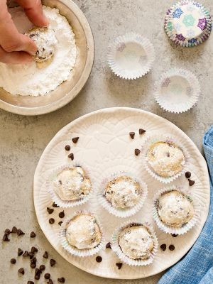These Chocolate Chip Snowball Cookies are little buttery cookies with a melt in your mouth texture covered in powdered sugar. They are the perfect size for your holiday cookie tray!
