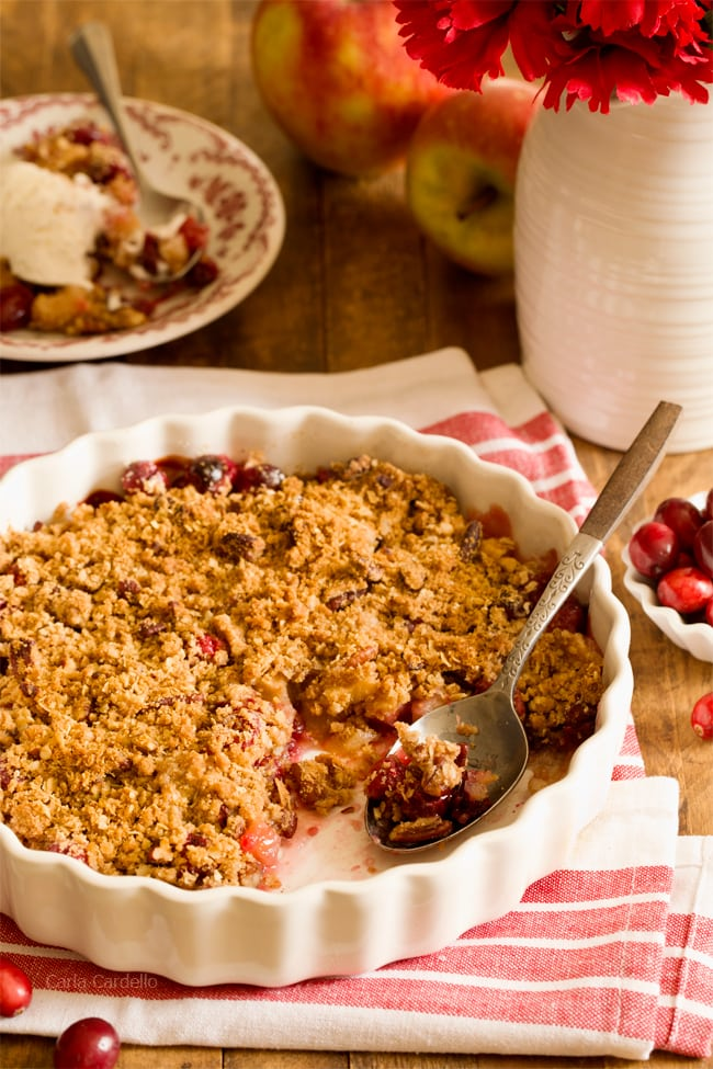 Stuck with extra cranberries and tired of cranberry sauce? Throw together this easy small batch Cranberry Apple Crisp with pecans. Warm and comforting in every bite!