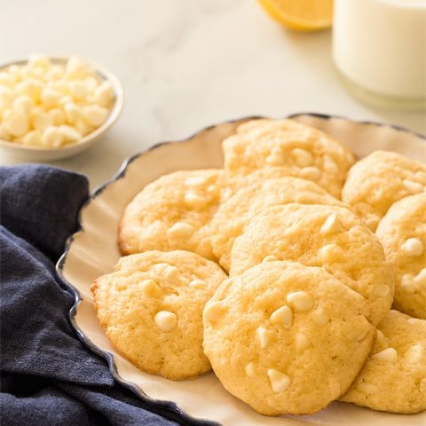 Add some brightness to your cookie tray with soft Lemon White Chocolate Chip Cookies! Recipe makes 1 dozen cookies with a punch of lemon and white chocolate.