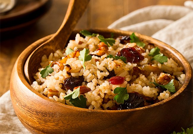 No more boring white rice when you add Pecan Cranberry Rice Pilaf with Caramelized Onions to the table! Serve it as a festive and hearty side dish for Christmas dinner or alongside meat as a comforting winter meal.