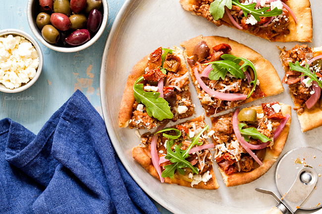 Put a Mediterranean twist on pizza night with Greek Pita Pizza! Top yours with ground lamb, olives, feta, pickled red onion, and arugula for an easy yet fulfilling meal.
