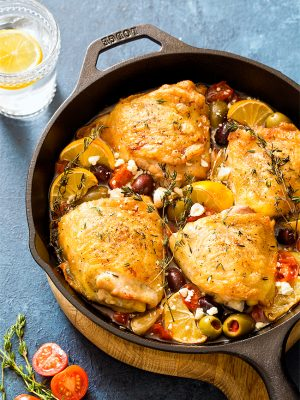 What's for dinner? When in doubt, go with chicken! Mediterranean Roasted Chicken Thighs with olives and tomatoes is a one pan meal with both a main and side dish cooked together as one recipe. Serve it as an easy chicken dinner for two.