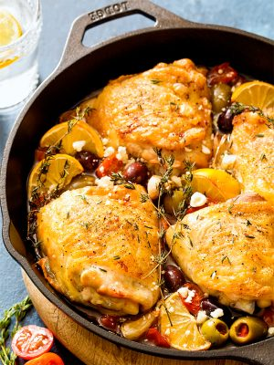 Mediterranean Roasted Chicken Thighs with olives and tomatoes is a one pan meal with both a main and side dish cooked together as one recipe