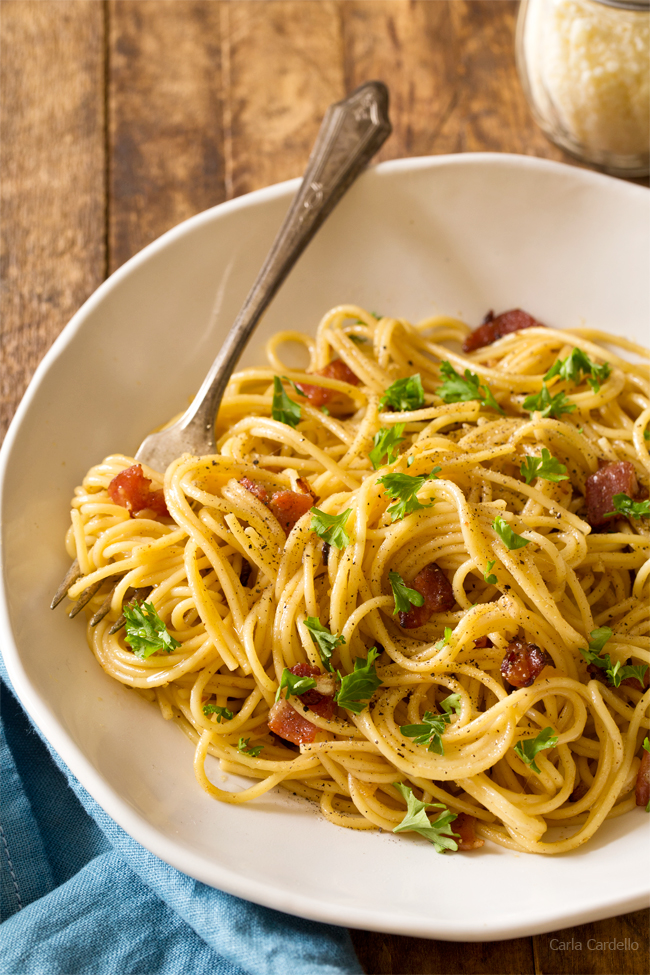 Have an easy romantic dinner at home with Spaghetti Carbonara For Two with bacon and cheese! Serve it with white wine and dessert for a stay-in date night.