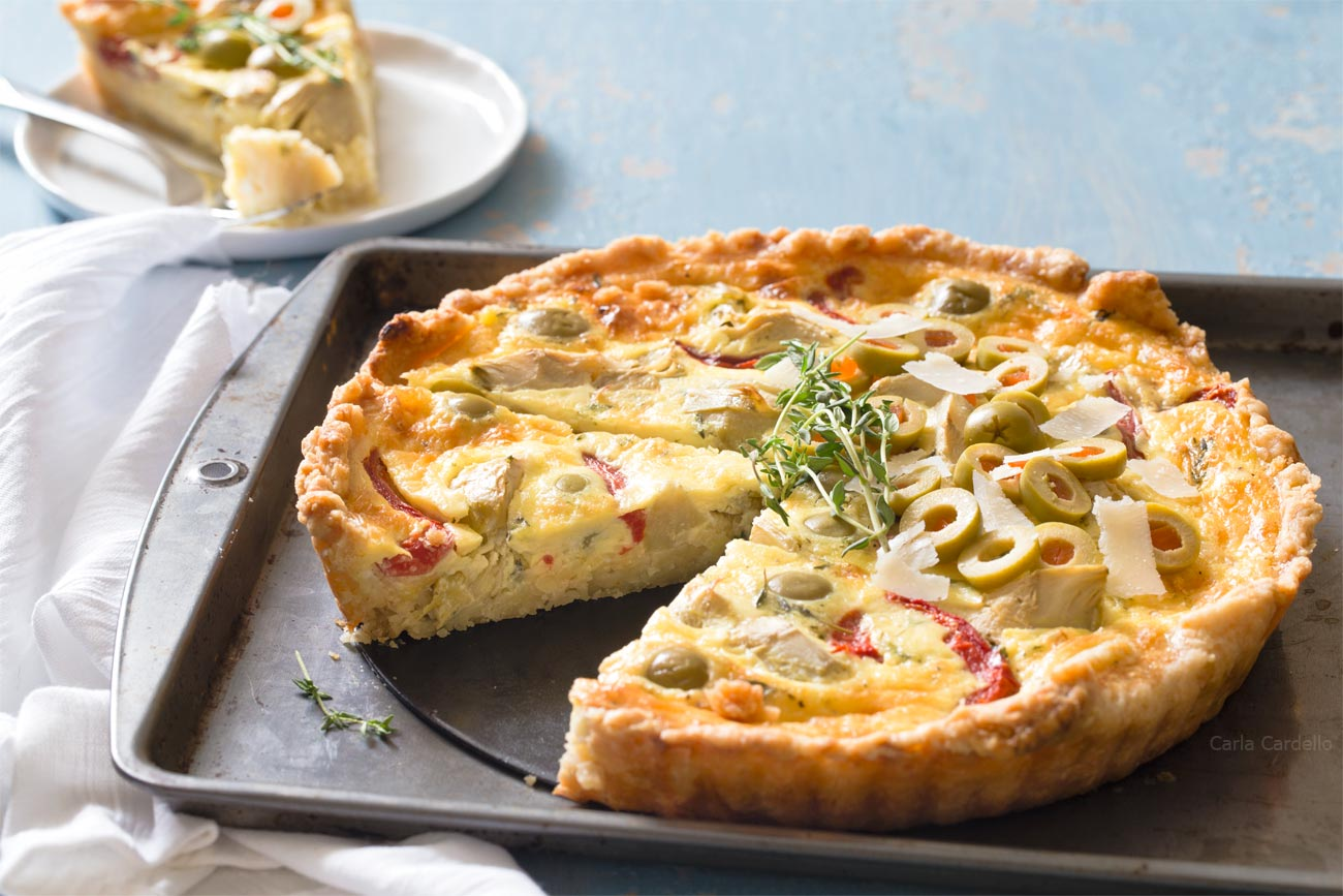 Slice of Artichoke Olive Quiche for brunch
