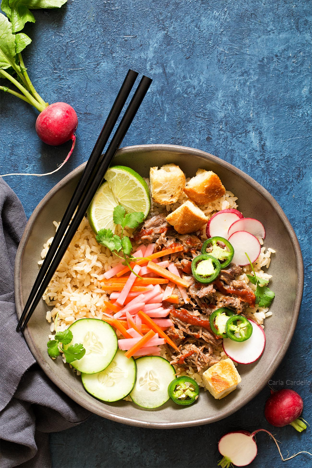 Slow Cooker Banh Mi Rice Bowls with pork, pickled vegetables, and baguette croutons.