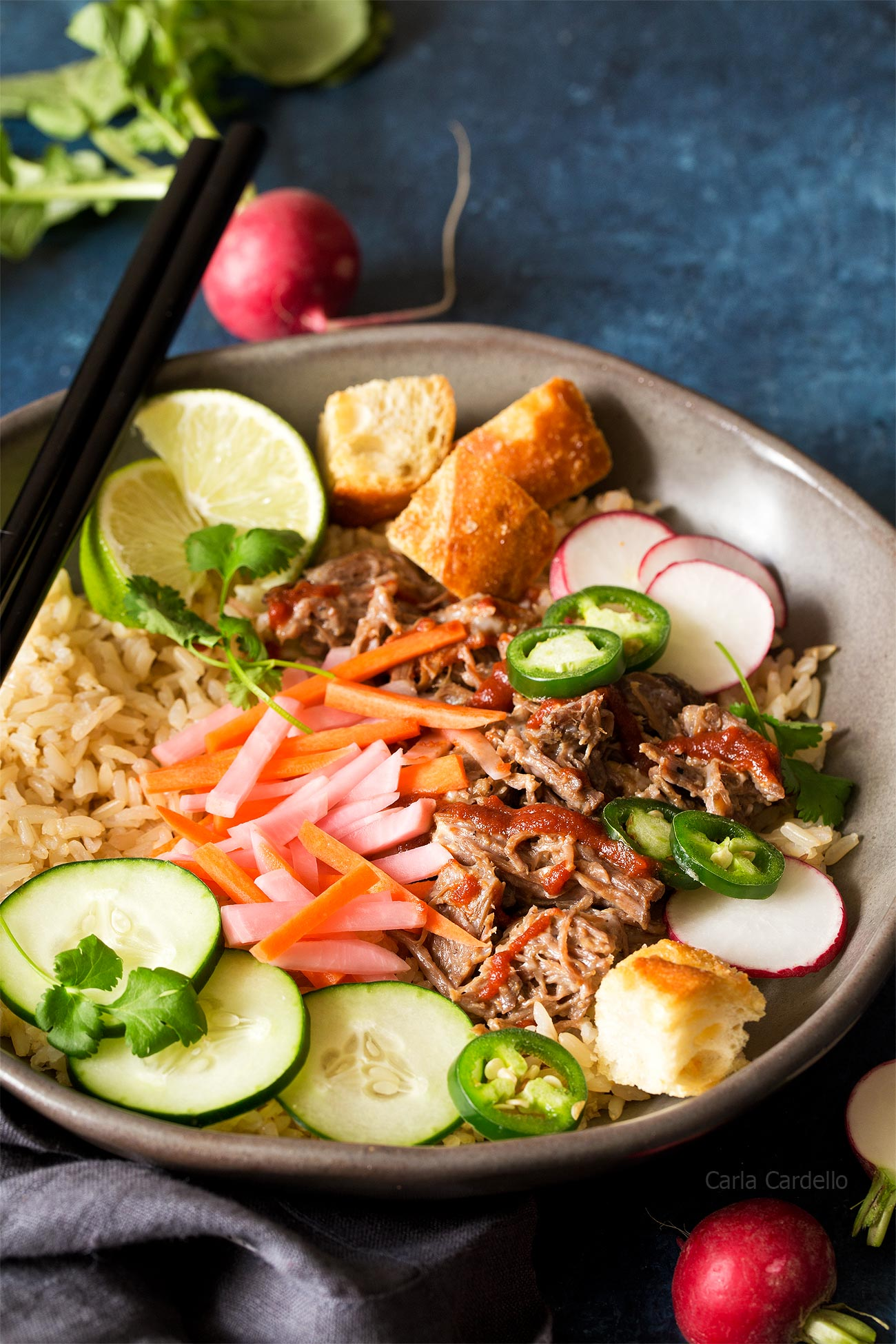 Slow Cooker Banh Mi Rice Bowls with shredded pork, pickled carrots, pickled radishes, and baguette croutons