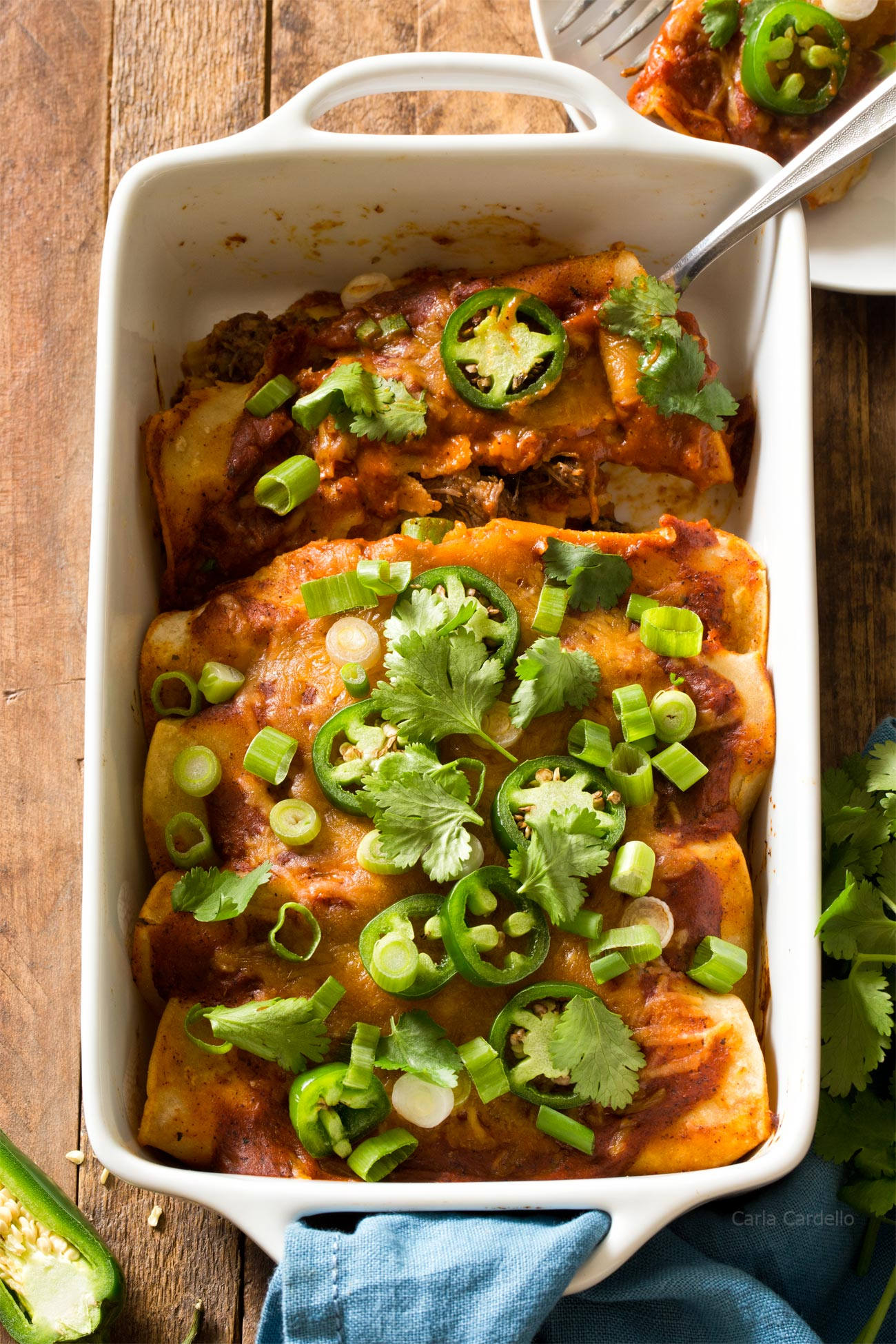 Slow Cooker Beef Enchiladas For Two stuffed with shredded beef, corn, black beans, jalapenos, and topped with cheese and a homemade enchilada sauce