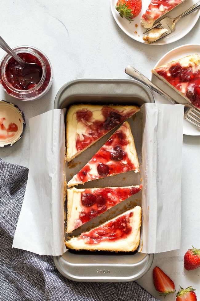 The best cheesecake recipe baked in a loaf pan! These Small Batch Strawberry Swirl Cheesecake Bars makes about 6 bars, ideal if you're looking for portion control.