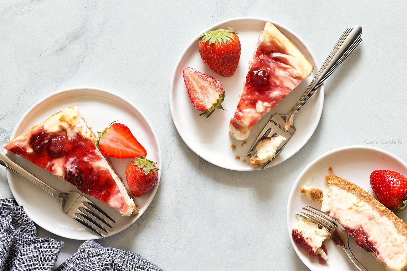 Small Batch Strawberry Swirl Cheesecake Bars cut into slices
