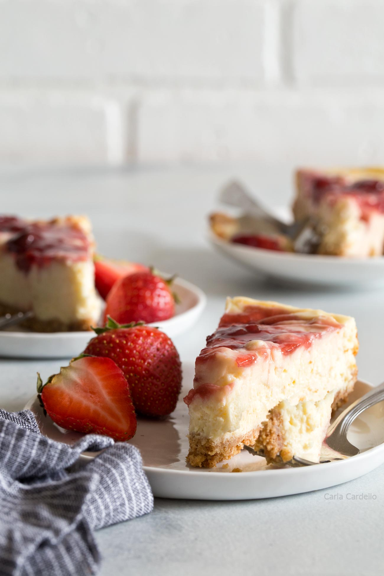 A slice of Small Batch Strawberry Swirl Cheesecake Bars