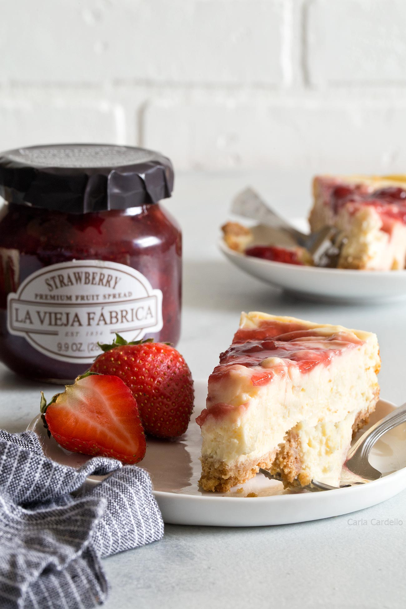 Small Batch Strawberry Swirl Cheesecake Bars made with La Vieja Fabrica strawberry fruit spread