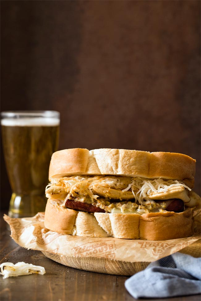 Polish Hill Pierogy Sandwich is Pittsburgh in a bite with kielbasa, pierogies, slaw, and beer mustard.