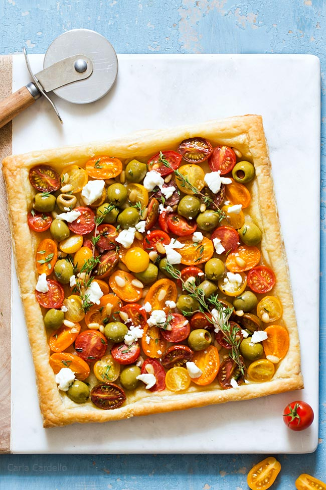 Tomato Puff Pastry Tart with Olives, Goat Cheese, and Pine Nuts