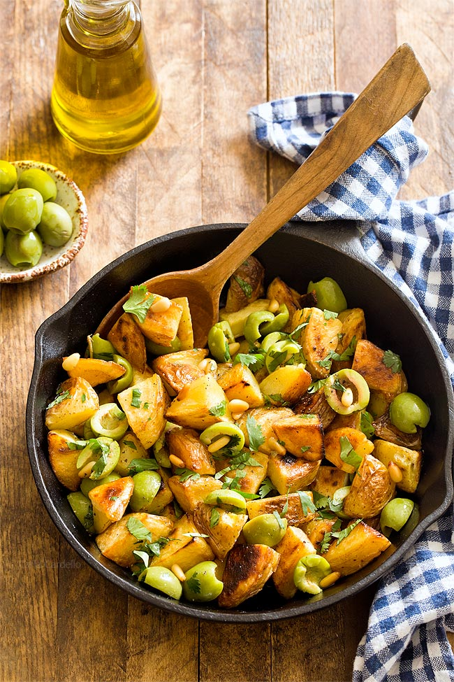 Small Batch Pan Fried Potatoes with Olives tossed with olive oil, parsley, and pine nuts.