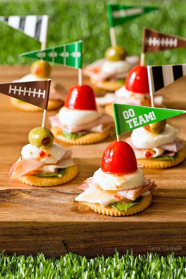 Antipasto Football Cracker Stacks with salami, turkey, ham, and mozzarella cheese