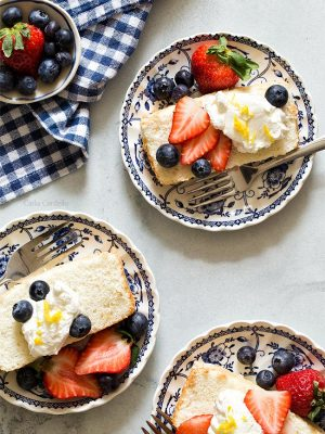 Angel Food Cake In A Loaf Pan with strawberries, blueberries, and whipped cream