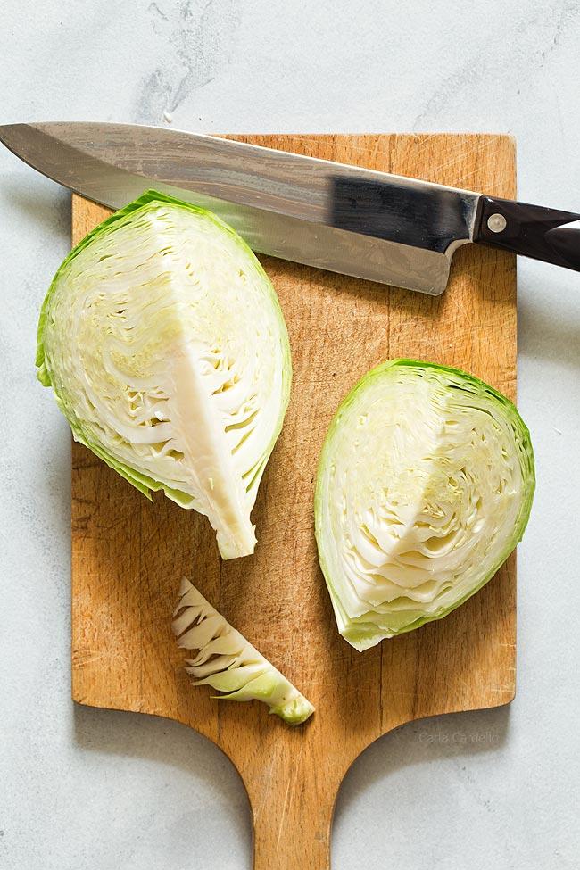 Cut each cabbage half in quarters
