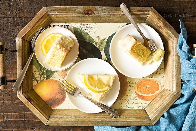 Slices of lemon cake on wooden tray