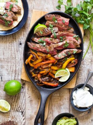 Steak Fajita meat and peppers in cast iron pan