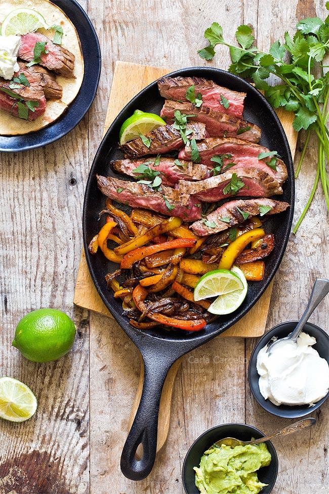 Steak Fajita meat and peppers in cast iron pan