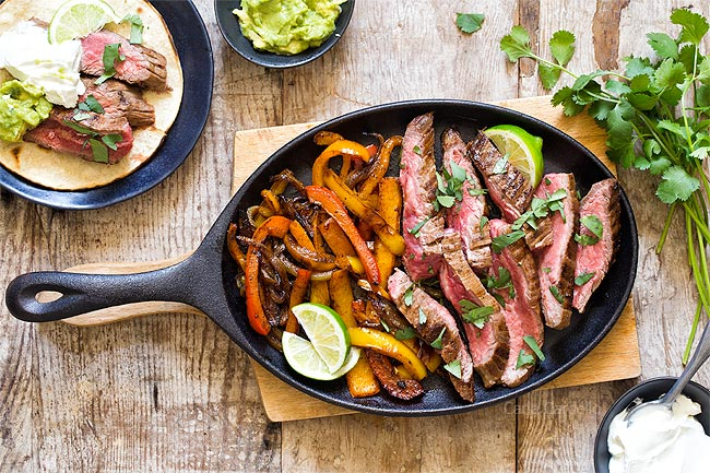 Steak and peppers served on cast iron pan
