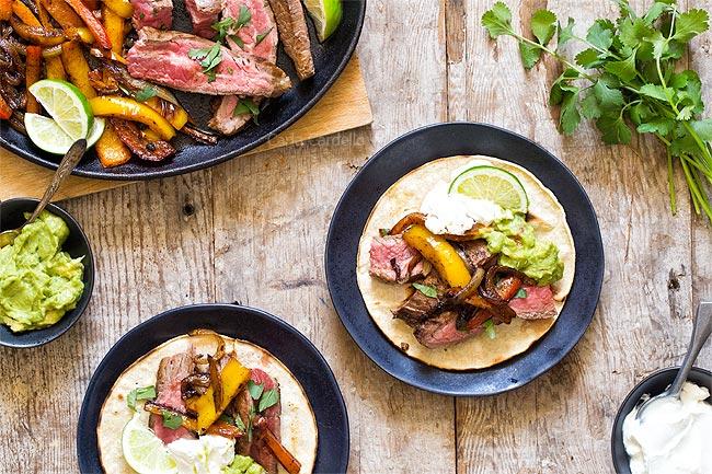 Steak fajitas served on tortillas