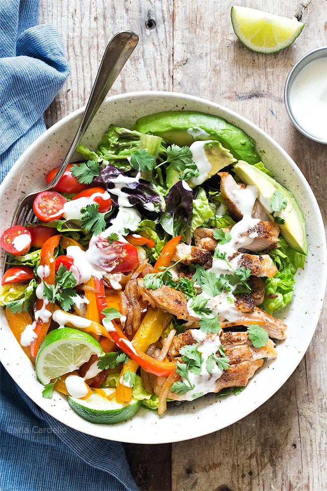 Chicken Fajita Salad with ranch drizzled on it