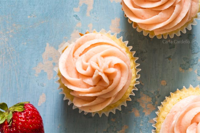 Strawberry buttercream piped on cupcake